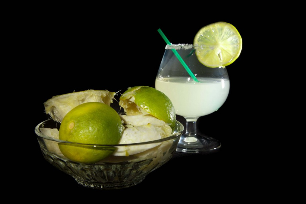 Margarita Cocktail And A Plate Of Squashed Lime